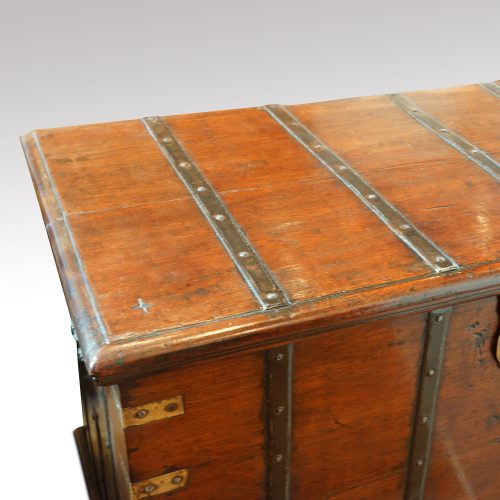 Antique teak trunk with iron straps and brass corners top