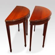 Edwardian pair of mahogany demi lune console tables side view