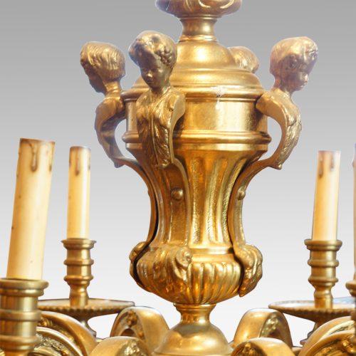 Edwardian brass 8 light chandelier figures
