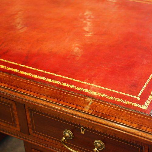 Edwardian inlaid mahogany pedestal desk leather detail