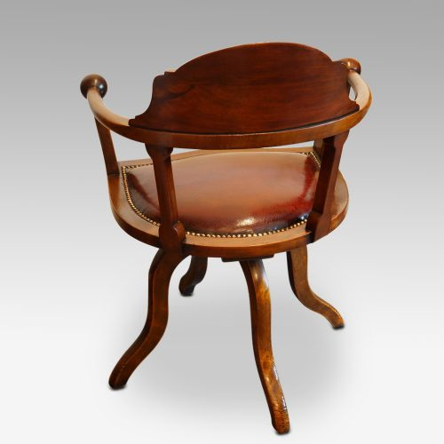 Edwardian mahogany ball arm revolving desk chair rear