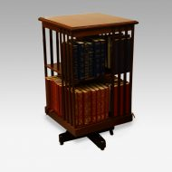 Edwardian mahogany revolving bookcase with books