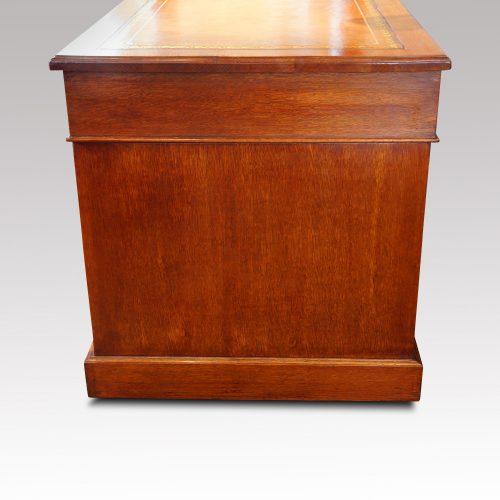Victorian oak double pedestal desk side view