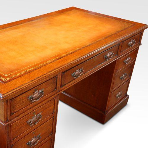 Victorian oak double pedestal desk top detail