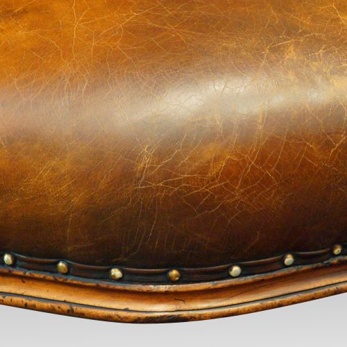 19thc. button back leather reading chair serpentine seat