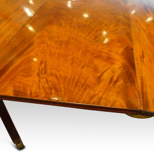Antique mahogany twin pillar dining table leaf detail