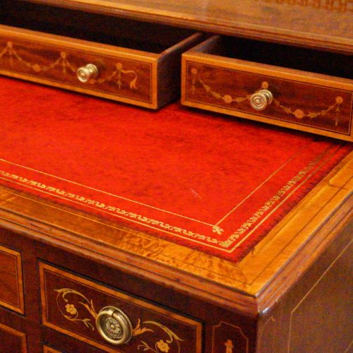 Edwardian inlaid writing table small drawers