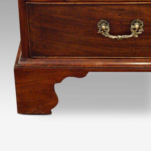 George III mahogany bureau shaped bracket foot