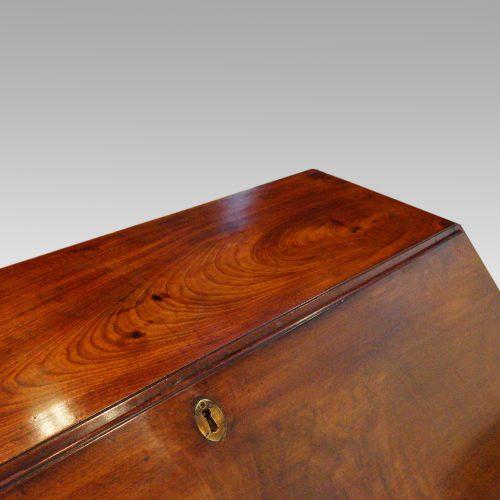 George III mahogany bureau top edge