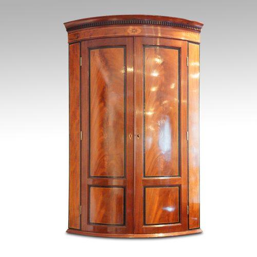 Georgian bow front mahogany hanging corner cabinet