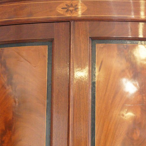 Georgian bow front mahogany hanging corner cabinet door detail