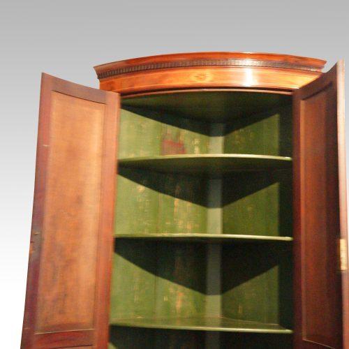 Georgian bow front mahogany hanging corner cabinet doors open