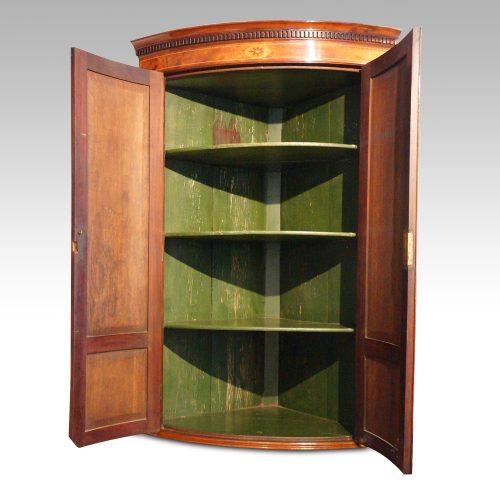 Georgian bow front mahogany hanging corner cabinet interior