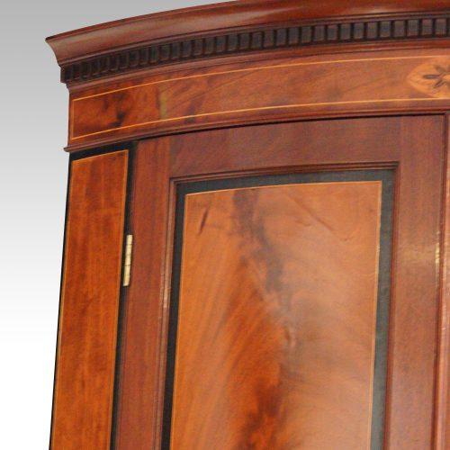 Georgian bow front mahogany hanging corner cabinet top panel