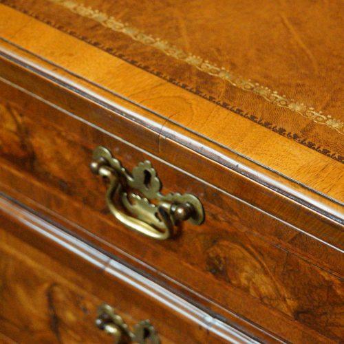 Georgian style walnut pedestal desk edge
