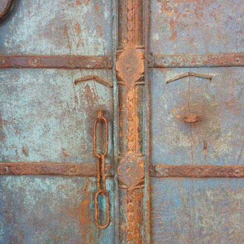 Indian carved teak doors with original paint central door jam