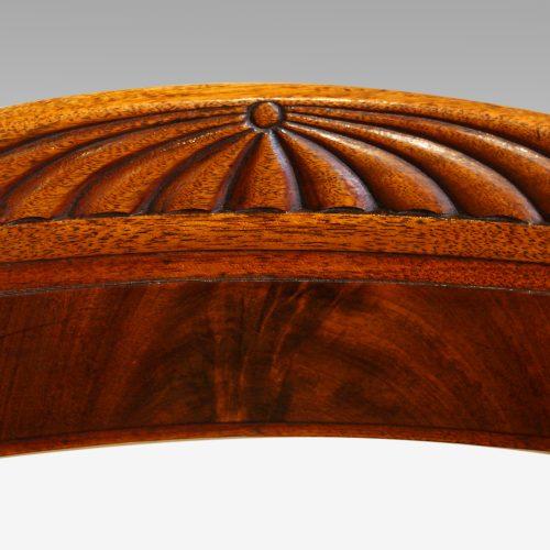William IV mahogany scroll arm desk chair crest