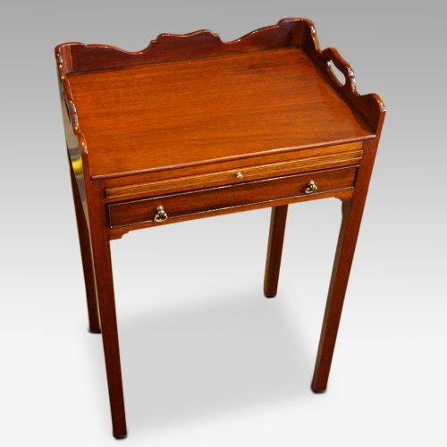 Pair of mahogany tray top bedside tables angle