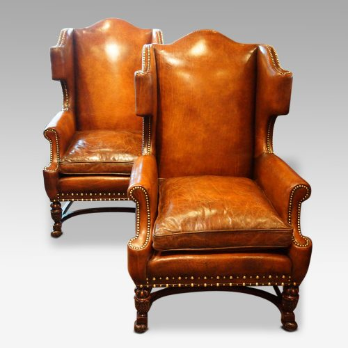 Pair of oak and leather wing chairs