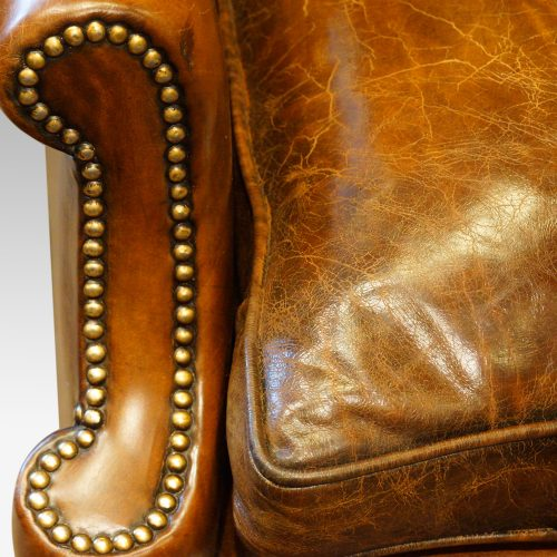 Pair of oak and leather wing chairs front of arm