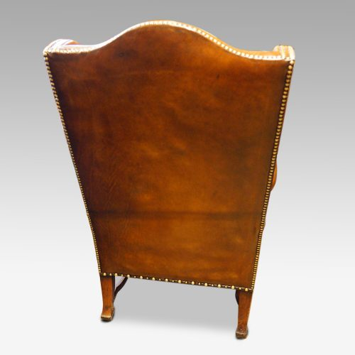 Pair of oak and leather wing chairs rear