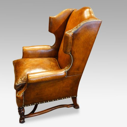 Pair of oak and leather wing chairs side view