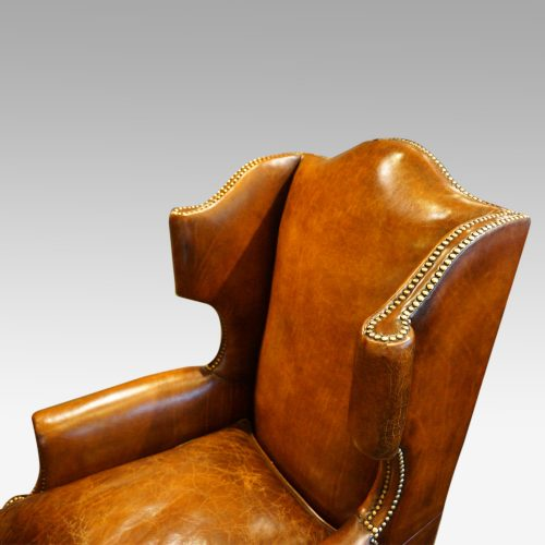Pair of oak and leather wing chairs wing