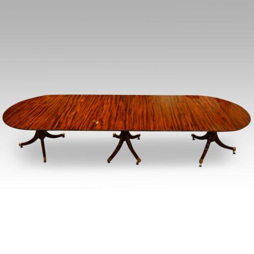 12 plus seat Regency style mahogany 3 pillar dining table