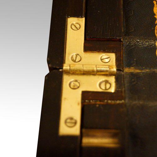 Antique coromandel writing slope hinge