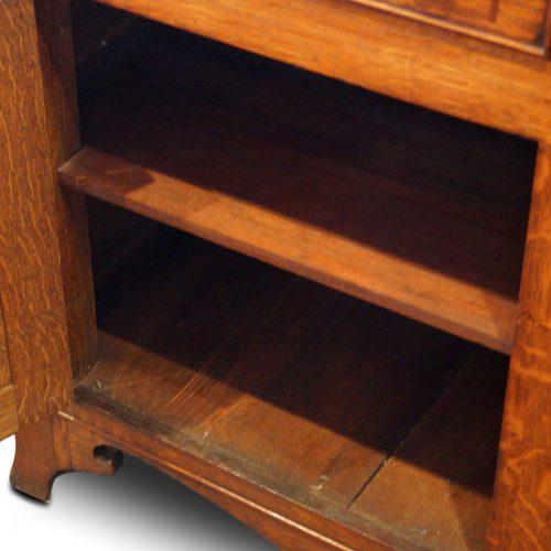 Antique oak Anglesey dresser base cupboard interior