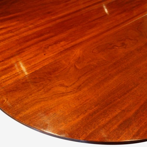 Regency style mahogany twin pillar dining table rounded end