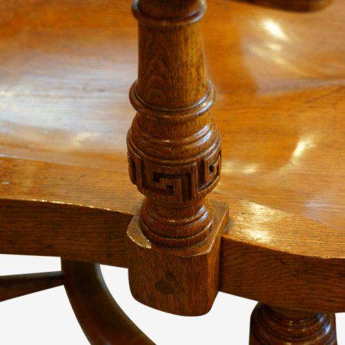 Edwardian oak desk chair by Bros. arm support