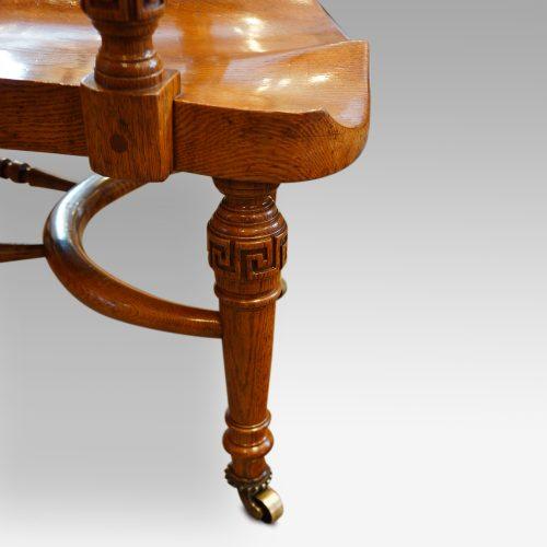 Edwardian oak desk chair by Bros. leg detail