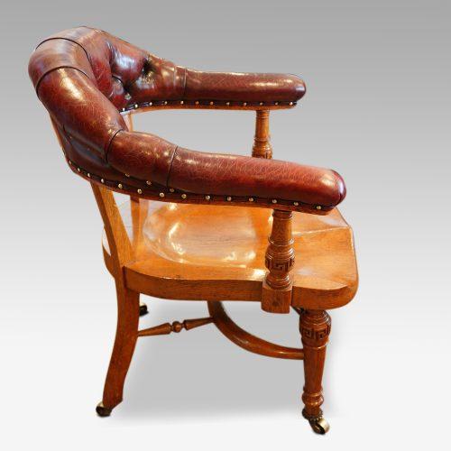Edwardian oak desk chair by Bros. side view