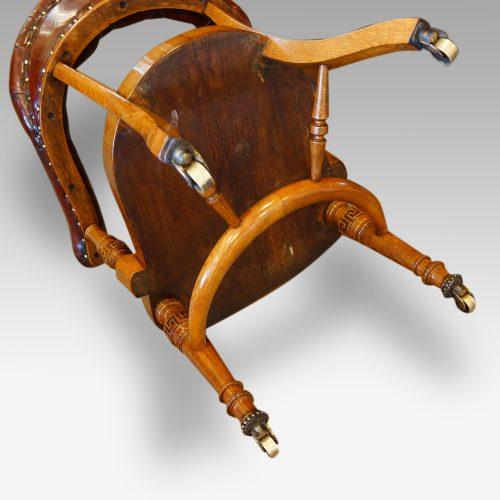Edwardian oak desk chair by Bros. underneath