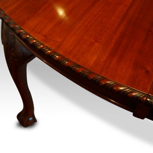 Maple & co mahogany extending dining table carved edge detail