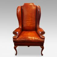 Queen Anne style high back leather wing chair