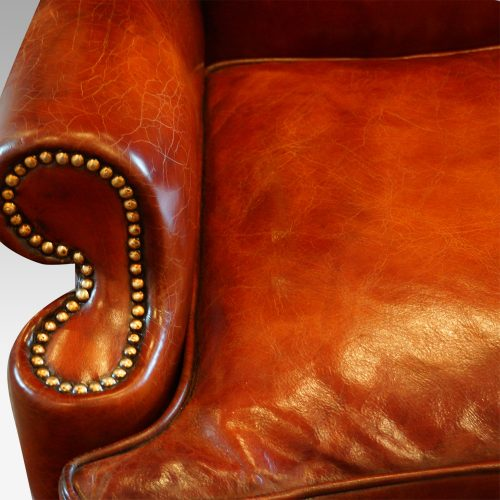 Queen Anne style high back leather wing chair arm