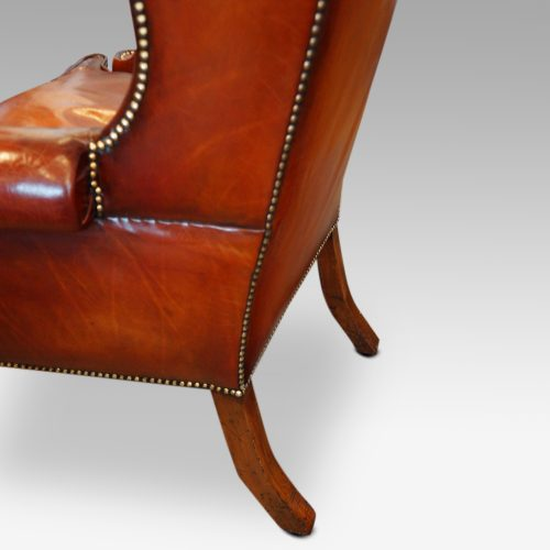 Queen Anne style high back leather wing chair back legs