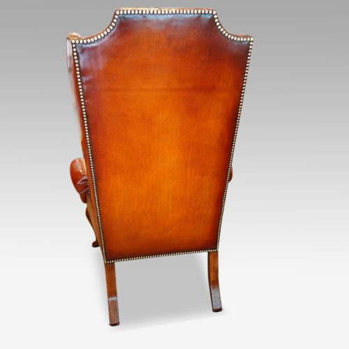 Queen Anne style high back leather wing chair rear