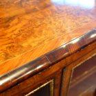 Victorian walnut open end credenza top detail
