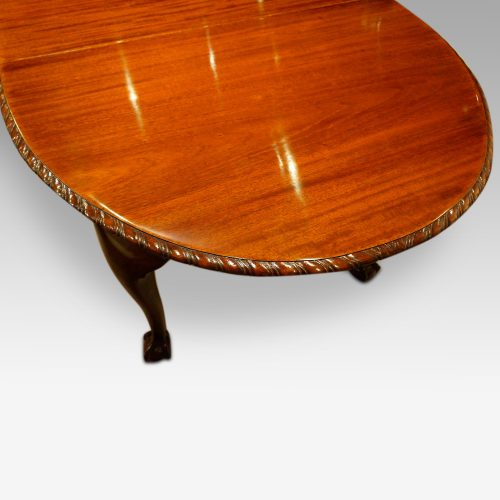 Waring and Gillow mahogany extending dining table bow end