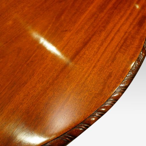 Waring and Gillow mahogany extending dining table carving