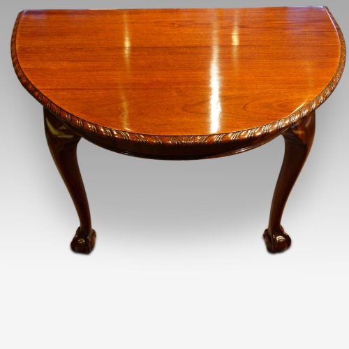 Waring and Gillow mahogany extending dining table end view