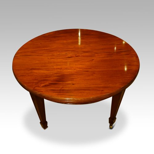 Edwardian circular mahogany dining table closed