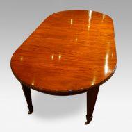 Edwardian circular mahogany dining table end view