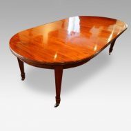 Edwardian circular mahogany dining table from corner