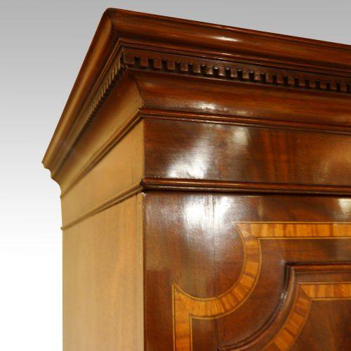 Georgian inlaid mahogany linen press cornice