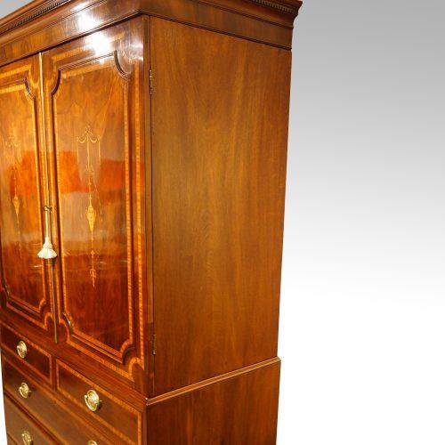 Georgian inlaid mahogany linen press side