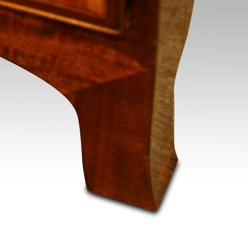 Georgian inlaid mahogany linen press splay foot